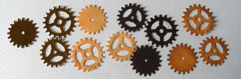 """Four colours of """"rusty"""" cogs"""